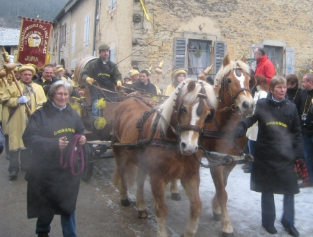 Wintry procession takes barrel of Vin Jaune to church