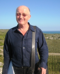 Wine Writer, Oz Clarke with the Mediterranean behind him ©Wink Lorch